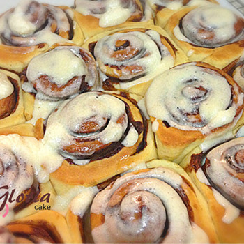Cinnamon Rolls, with melted cream cheese